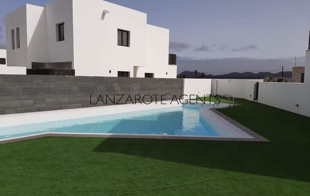 Unique Opportunity To buy an Immaculate New Built Villa in Yaiza in a Lovely Newly Built Complex with Communal Pool and Garage