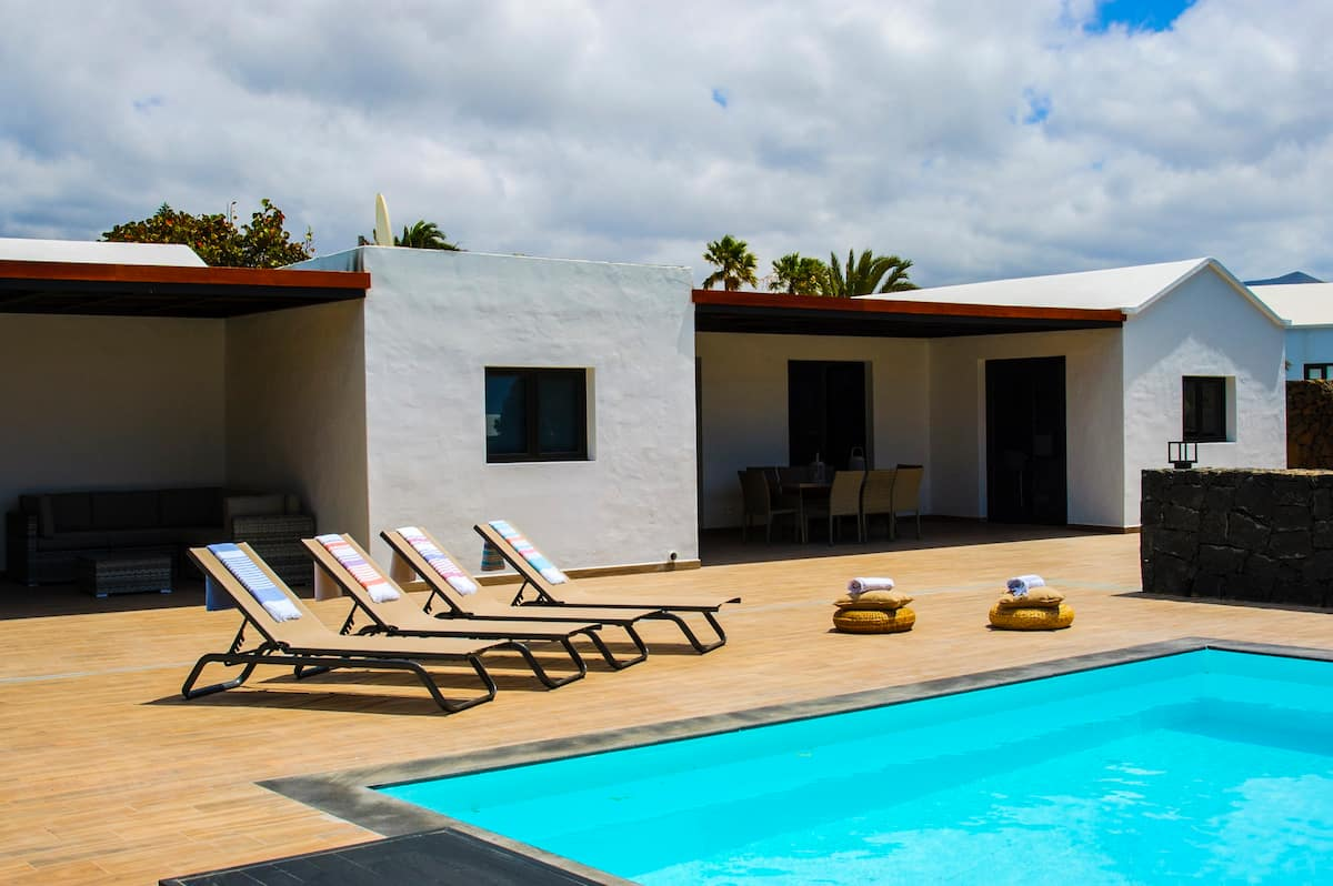 Modern detached villa located in an exclusive development with walking distance to all amenities and beaches.