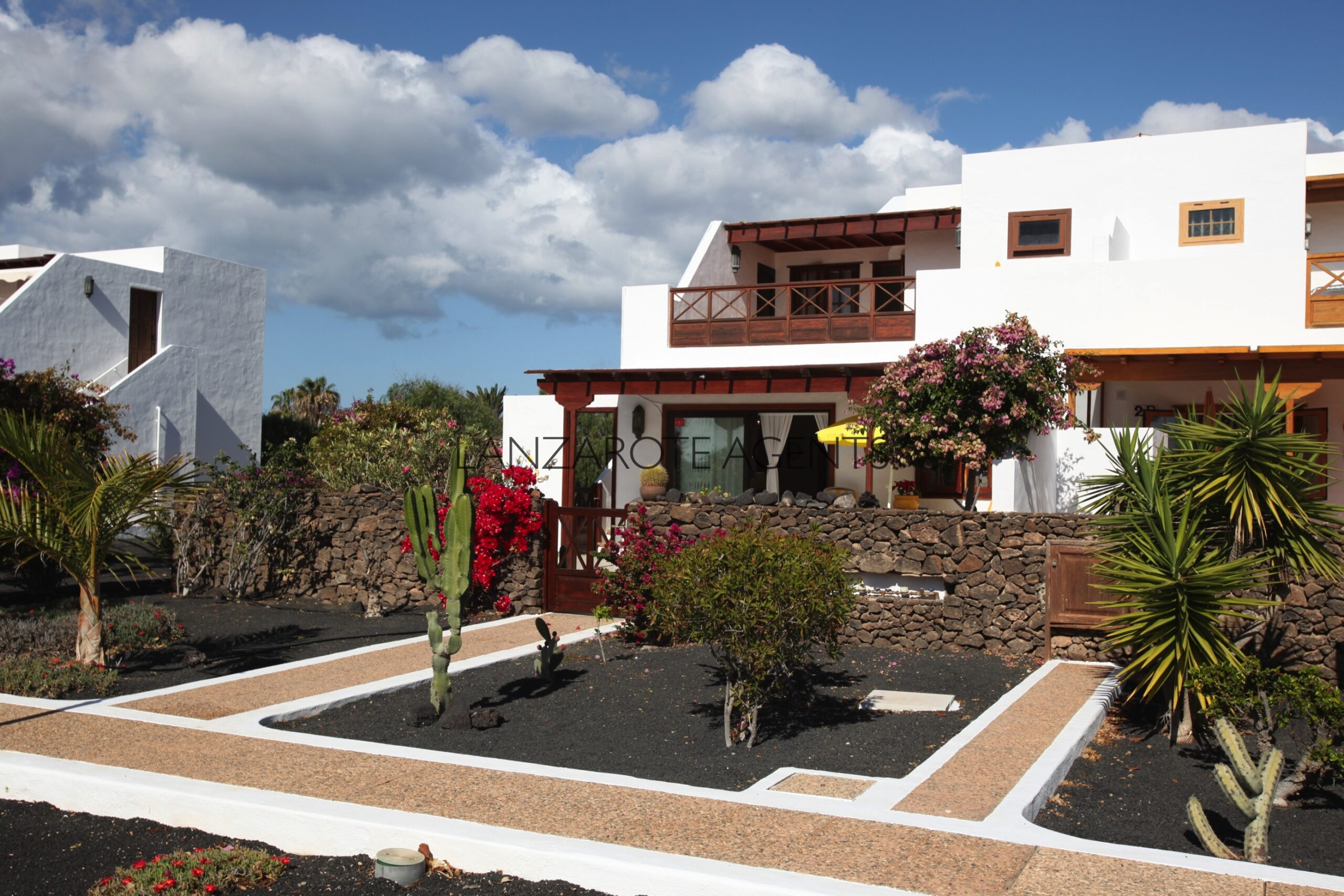 Charming Semi Detached Villa on Established Complex  with Heated Communal Pool, Close to Playa Blanca Town Centre.
