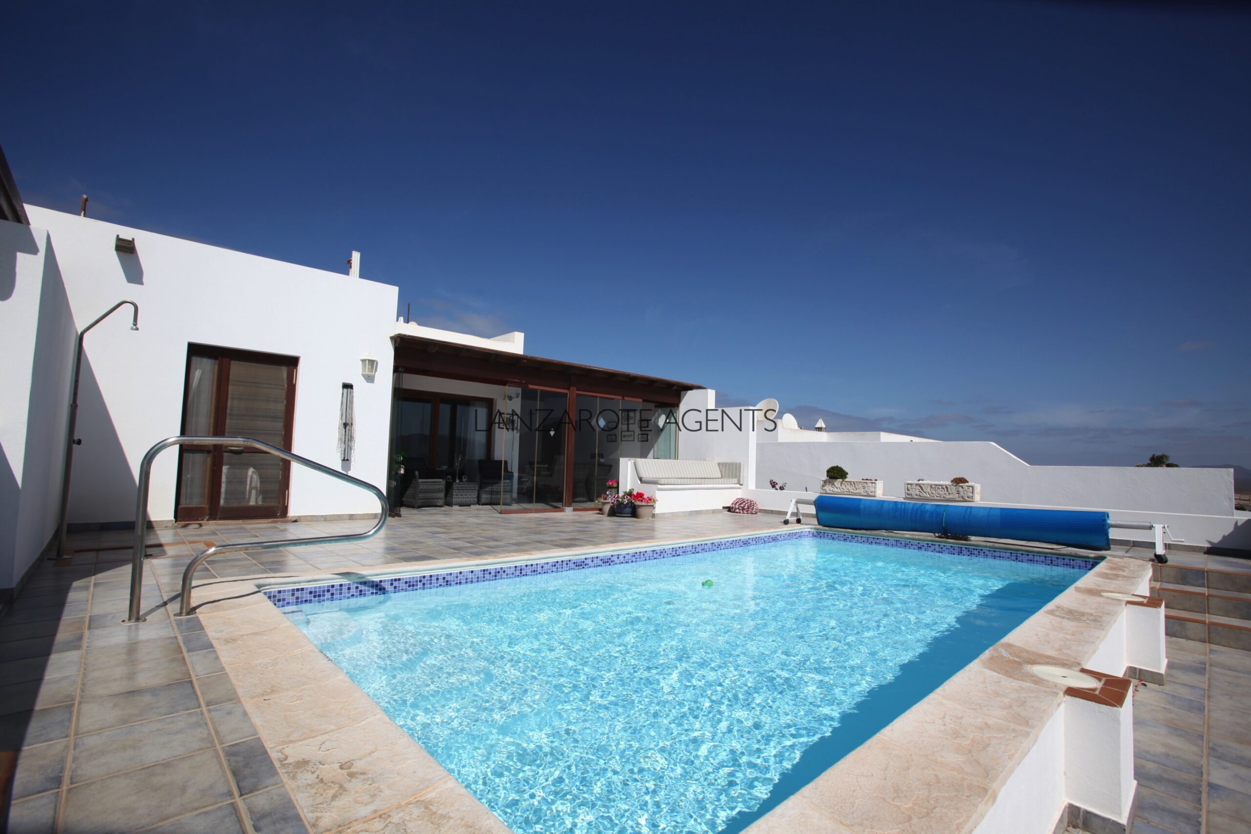 Best Panoramic Views in Playa Blanca From this Semi Detached Three Bedroom Villa with Garage and Heated Pool
