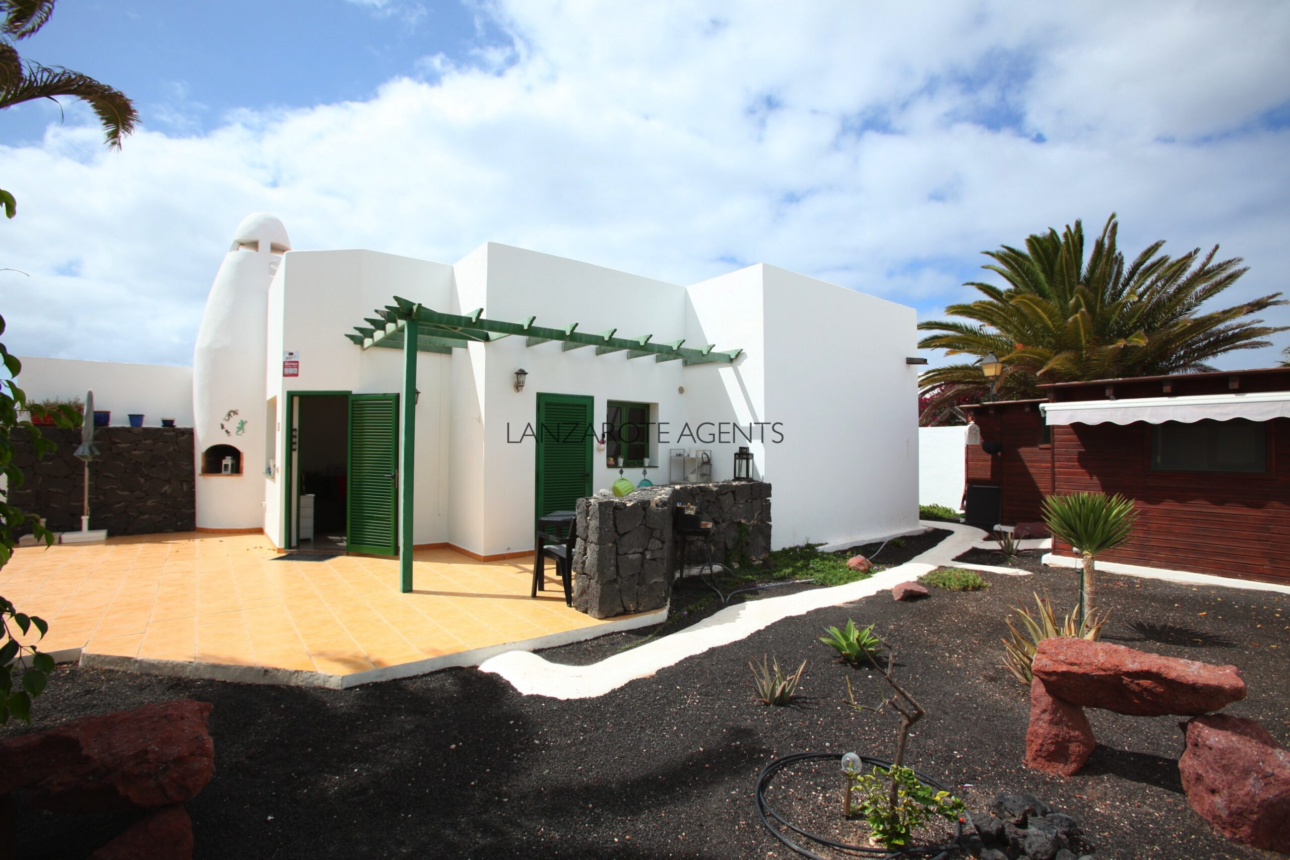 Semi Detached Bungalow in Playa Blanca, with a Self Contained Apartment and Mature Gardens in a Complex with Communal Pool and Tennis Court